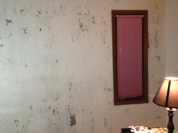 This is how my wall looks after scraping off the wall paper.