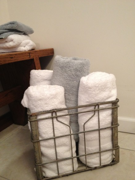 My towels in my Biltmore Dairy milk crate. Bench is from the dining room